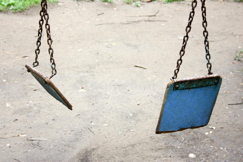 The end of childhood. Violence in the family. Concept. Broken swing. Photo for your design royalty free stock photography