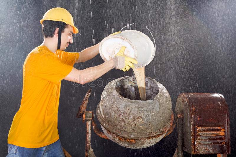 Download Worker Is Cleaning Cement Mixer While Big Rain Is Falling Stock Photo - Image of dirty, business: 30306128