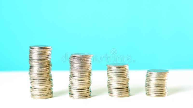 End of Financial Year and savings concept with stacked coins and copy space. End of Financial Year and savings concept with piles of stacked coins and copy stock photos