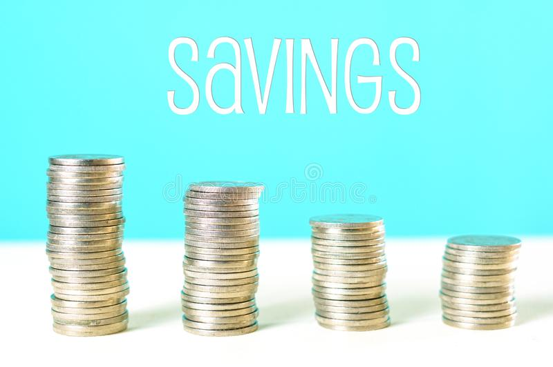 End of Financial Year and savings concept with stacked coins and copy space. End of Financial Year and savings concept with piles of stacked coins and text stock images