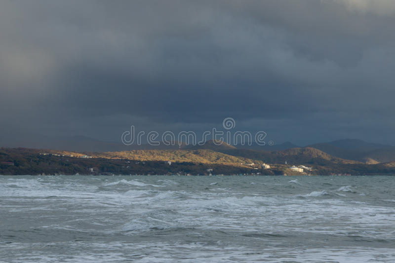 End of gale. Closing stormy date at the Black sea. Sunlight fell upon the Caucasus Mountains royalty free stock photo