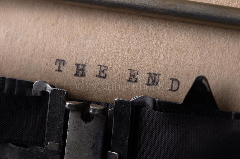 The end - inscription made by old typewriter. Vintage inscription made by old typewriter, The end, antique, communication, journalist, letter, message, obsolete stock images