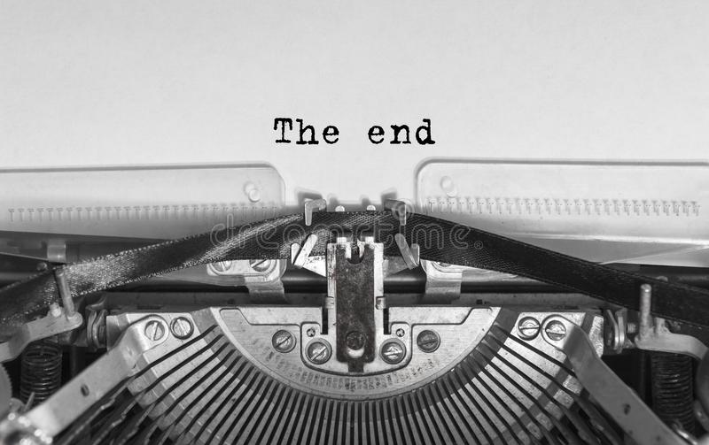 The end inscription in a vintage typewriter. royalty free stock photography