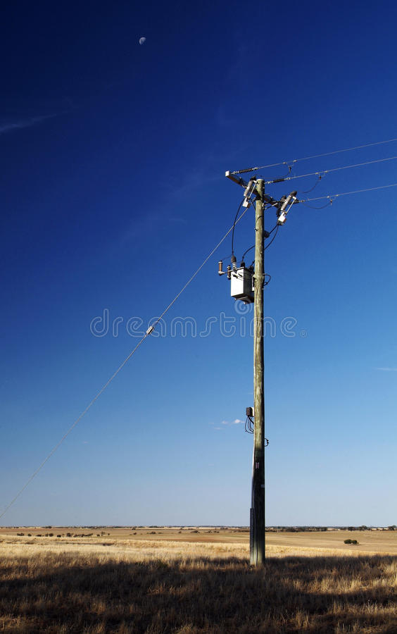 End of the Line. A lone power pole in a flat, empty field royalty free stock photography