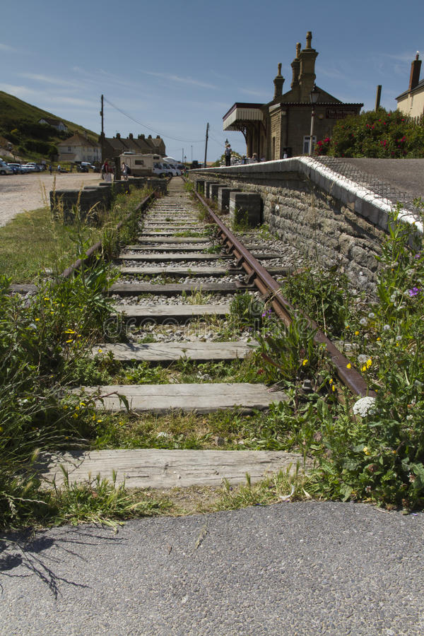 End of the line (railway). Stretch of railway by an old station (now a tea room). Bridport West Bay station Maiden Newton – Bridport line, West Bay Branch royalty free stock images