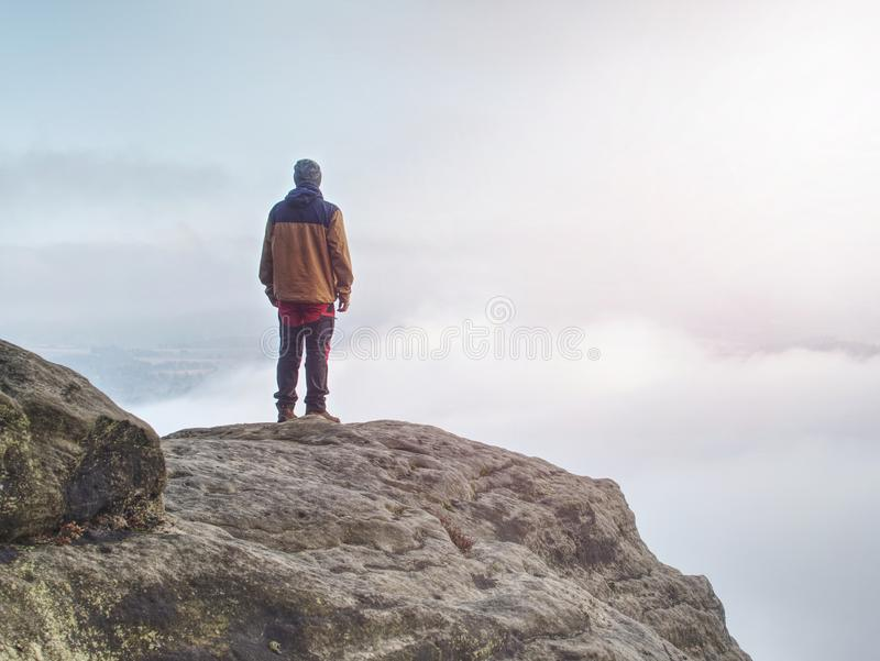 End of misty road in mountains. Boy stay suddenly on edge royalty free stock photo