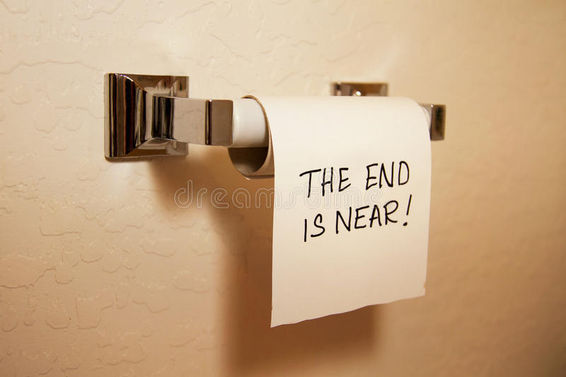 The End Is Near!. Bathroom toilet tissue at the end of the roll, predicting the end is near stock images