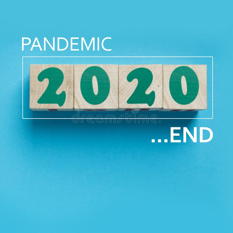 The End of Pandemic in 2020 in wooden blocks with copy space royalty free stock photography
