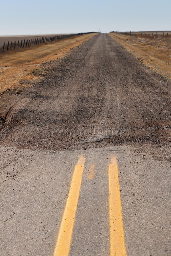 End of paved road royalty free stock photo