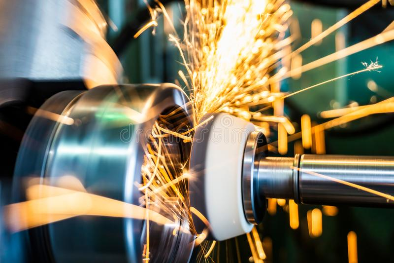 End processing of a metal surface with an abrasive stone on a circular grinding machine, sparks fly in different directions.  stock photography