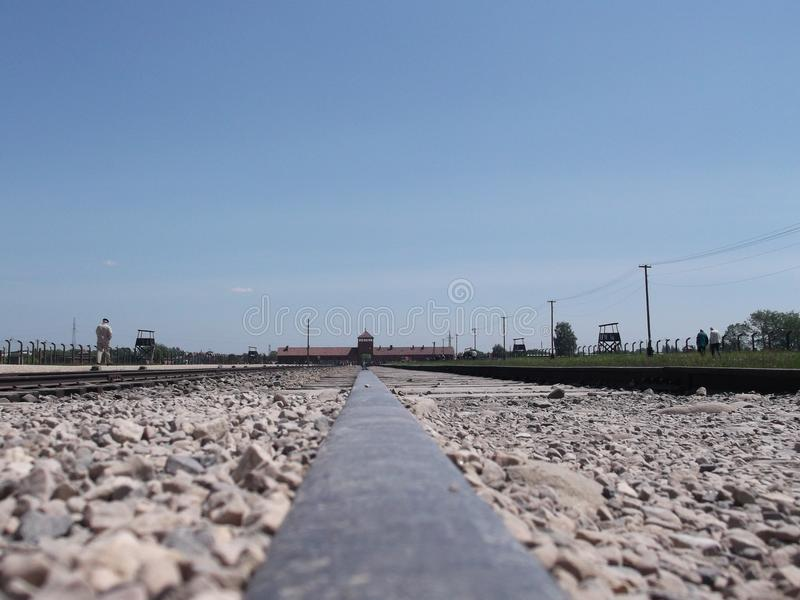 End of railroad track of concentration camp in Auschwitz Birkenau stock image