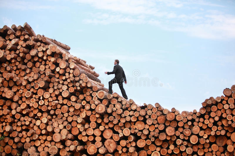 End of recession- Business Man on his way to the top royalty free stock image