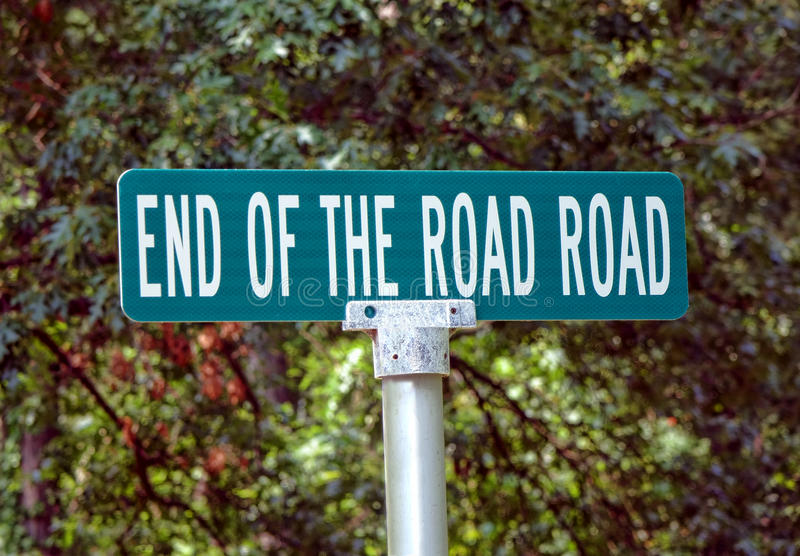 End of the Road Road Humoristic Street Sign Pole stock photo
