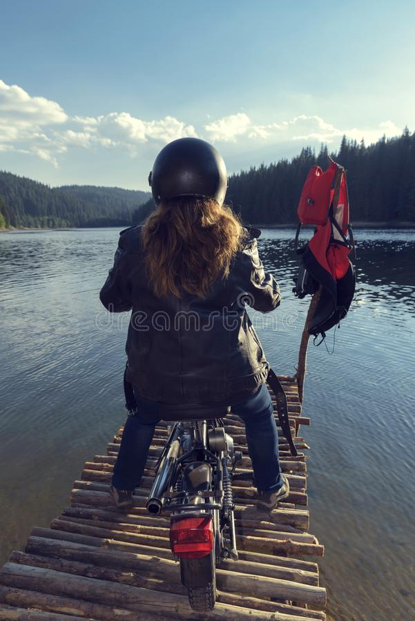 End of The Road Woman Motorcycle Rider Eternity. Selective focus royalty free stock photo