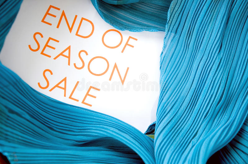 End of season sale. Wording with blue clothing stock images