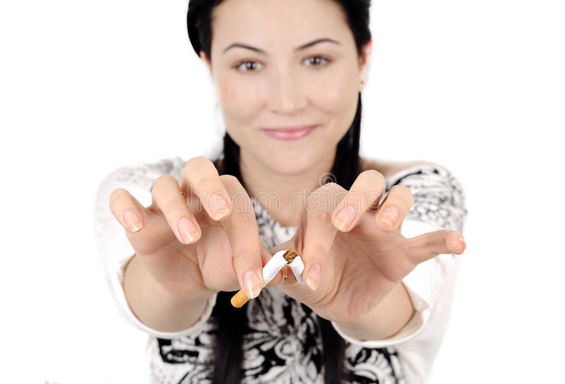 End of smoking. Young attractive woman quiting smoking isolated royalty free stock photo