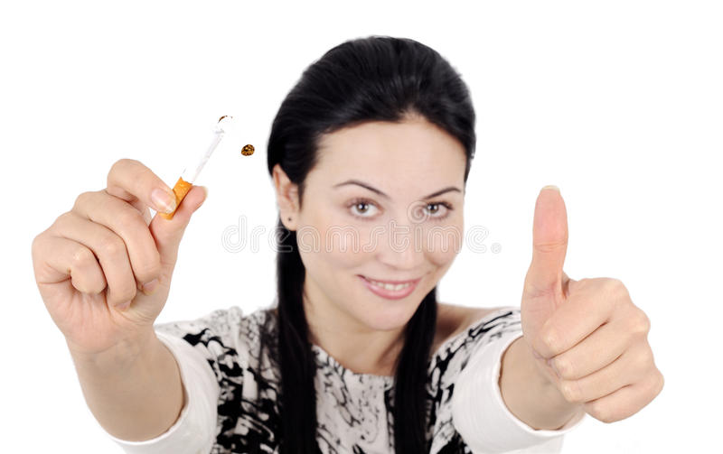 End of smoking. Young attractive woman quiting smoking isolated. young women smiling ok stock images
