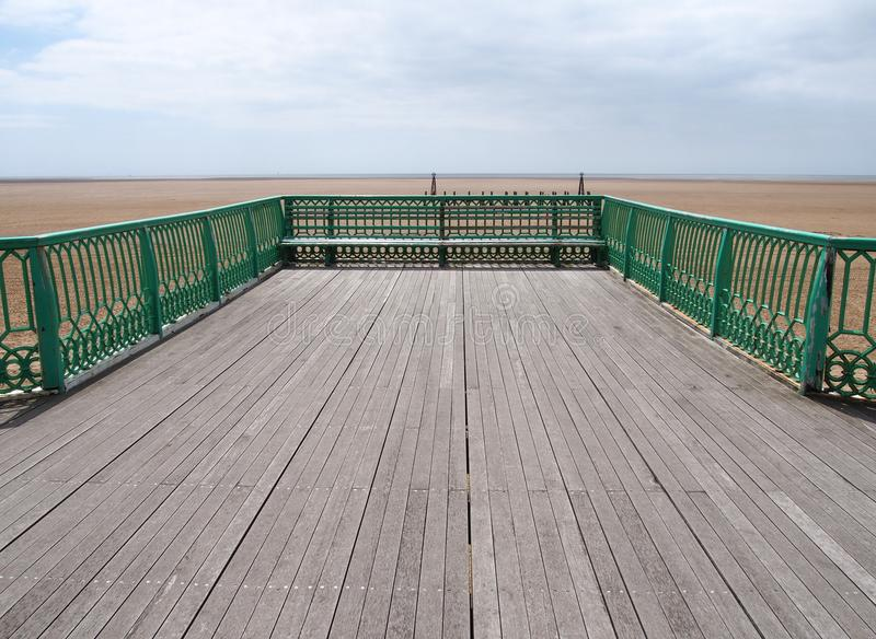 The end of the victorian pier at St Annes on sea in lancashire looking out onto the beach at low tide with the sea in the distance. The end of the victorian pier royalty free stock photos