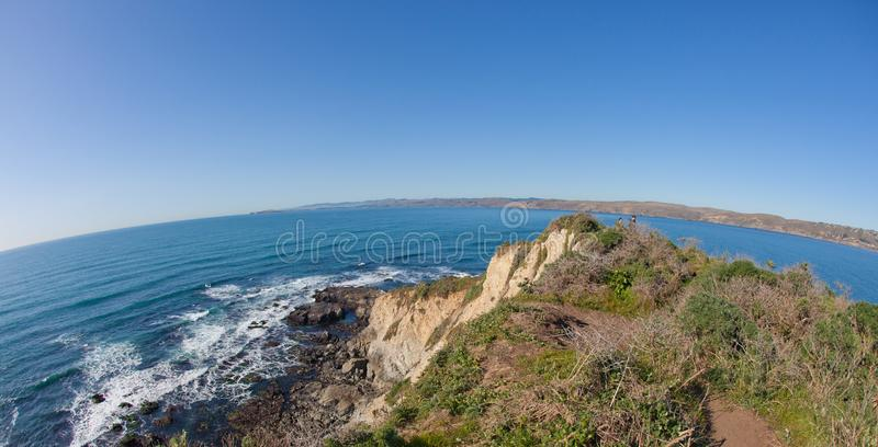The end of the world. Point Reyes, United States - March 03, 2012 : An hiker is walking towards the point where the american and asian plate come together. A stock photos
