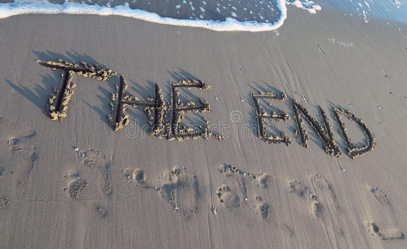 THE END written on the beach while the wave comes royalty free stock images