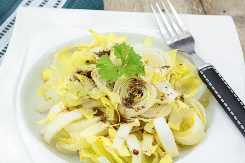 Endive salad with balsamic vinegar stock photo