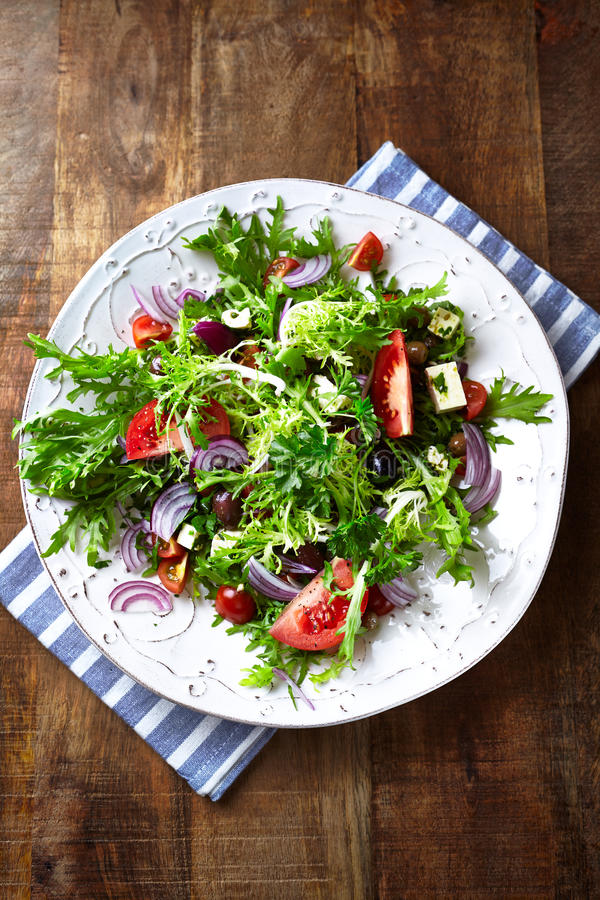 Endive Salad with Tomato, Olives and Feta stock image