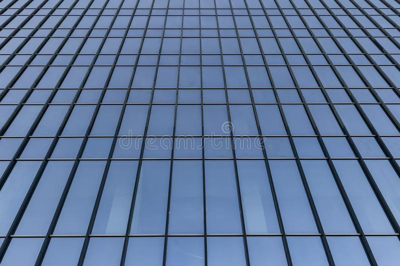 Endless glass and steel wall of skyscraper, modern building architecture of business center, abstract curved lines stock image