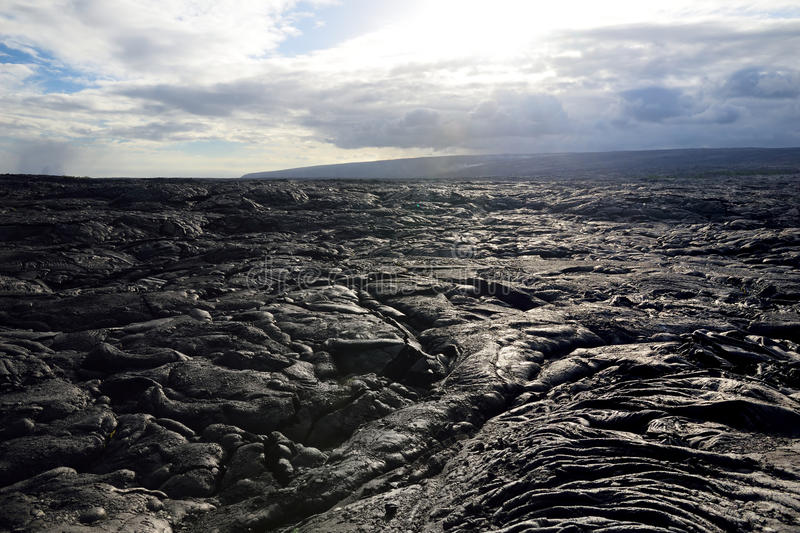 Endless lava fields of the Big Isalnd of Hawaii. Smooth, undulating surface of frozen pahoehoe lava. Hawaii, USA royalty free stock images