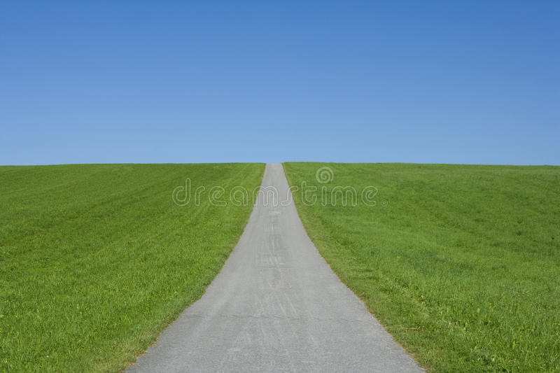 Endless road. On a grassy knoll royalty free stock images