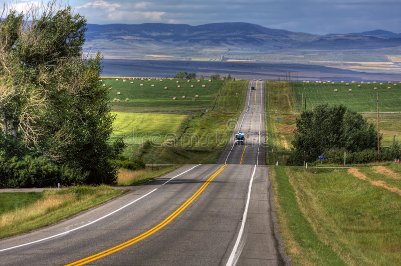 Endless road. In the Southern Alberta prairies royalty free stock images