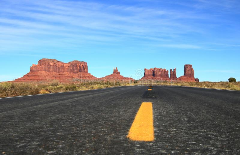 Endless Road - Monument Valley Highway - Low Perspective - Large File. Low perspective of the miles long road that leads through Monument Valley on the border of royalty free stock images