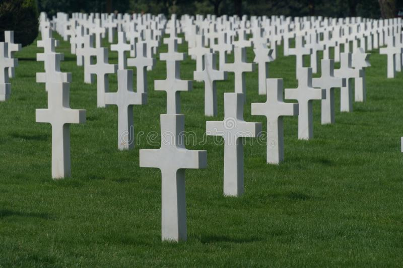 Long rows of white crosses at the Normandy American Cemetery and Memorial, Colleville-sur-Mer, Normandy, France. Endless rows of white crosses at the American royalty free stock photography