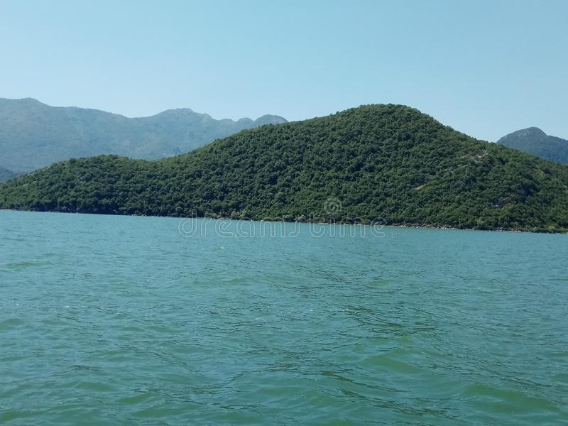 The endless Skadar Lake, surrounded by the majestic mountains in Montenegro. stock photo
