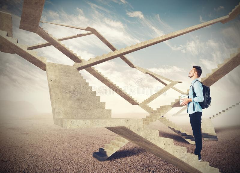 Endless stairs of future. Student watching the endless stairs of future royalty free stock photo