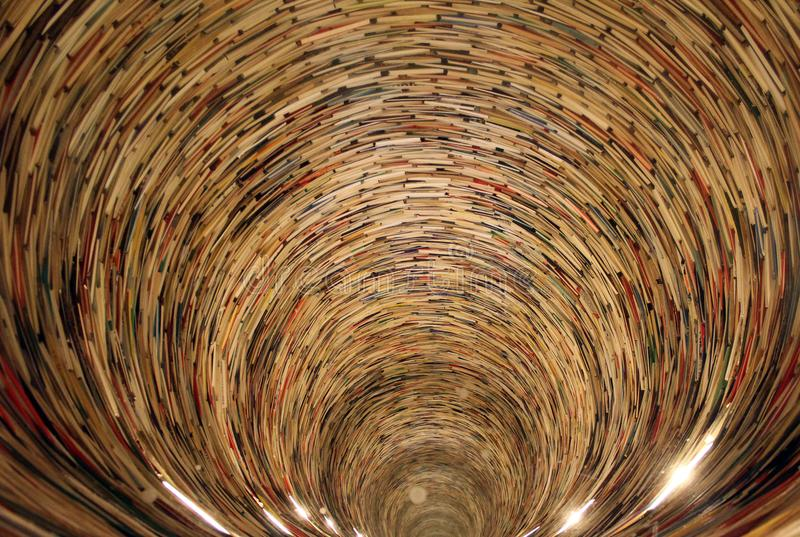 Endless tunnel of books stock photos