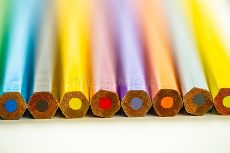 Ends of colored pencils lie on a light background royalty free stock photo