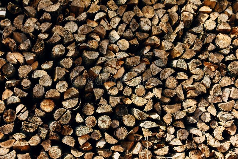 Ends of logs wooden background. toning. wood in the stack stock photo