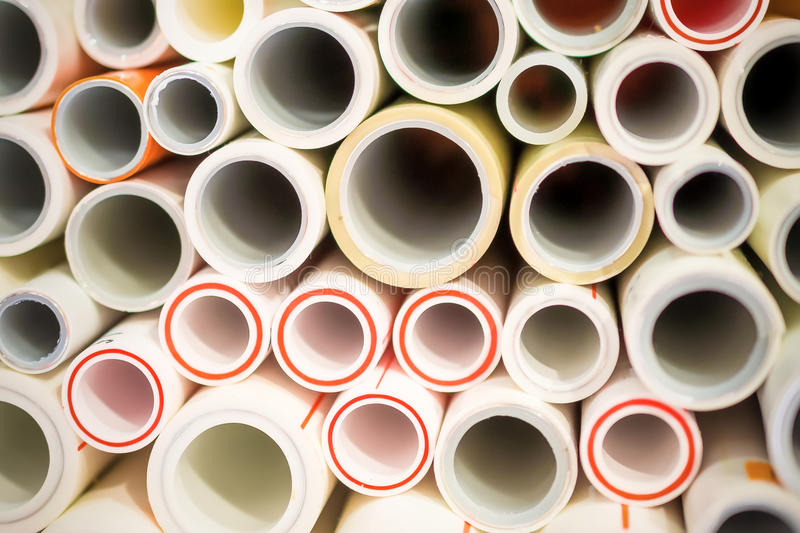 The ends of polypropylene and plastic pipes. Abstract industrial background royalty free stock images