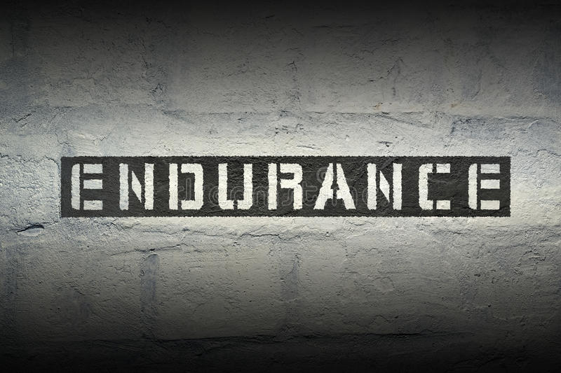Endurance word gr. Endurance stencil print on the grunge white brick wall royalty free stock photos