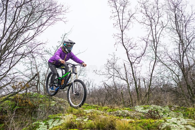 Enduro Cyclist Riding the Mountain Bike on the Rocky Trail. royalty free stock images