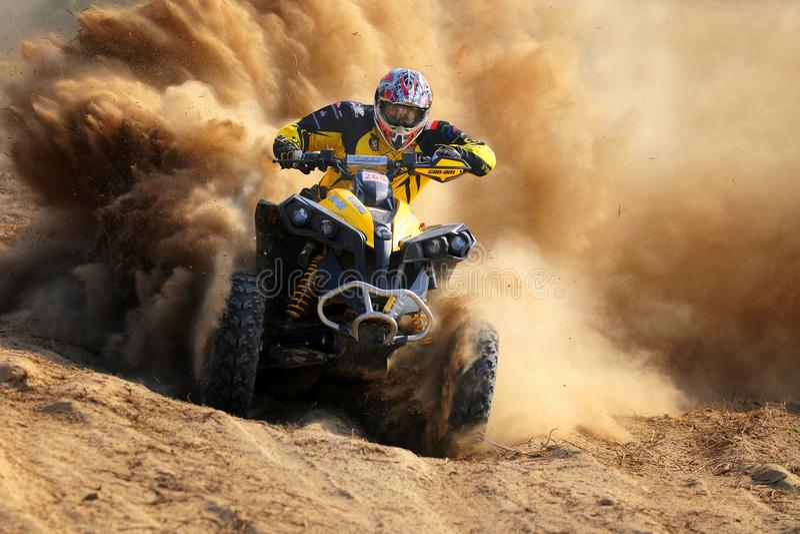 Enduro race. Quad beat the sandy turn of the enduro race royalty free stock image