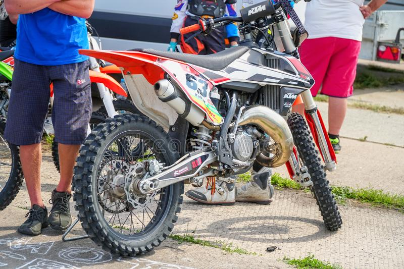 Enduro racing motorcycle in the Parking lot. Side View. Motocross bike. Samara, Russia - August 17, 2019: Enduro racing motorcycle in the Parking lot. Side View royalty free stock images