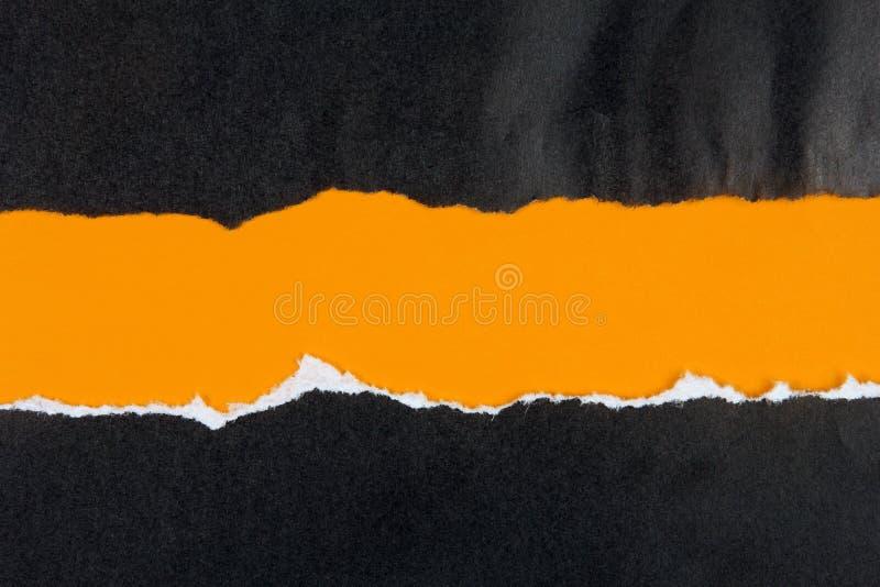 Enegreça o papel rasgado, espaço alaranjado para a cópia imagens de stock royalty free