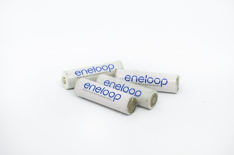Eneloop uppladdningsbara batterier som isoleras på en vit bakgrund arkivfoton