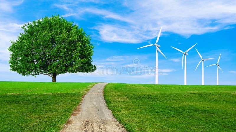 Energ?a renovable con las turbinas de viento en colina verde Fondo ambiental de la ecolog?a para las presentaciones y las p?ginas foto de archivo