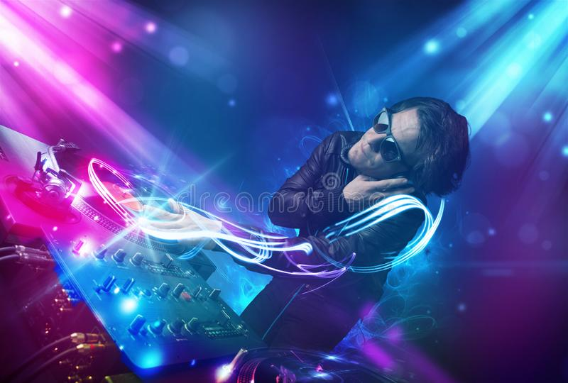 Energetic Dj Mixing Music With Powerful Light Effects Stock