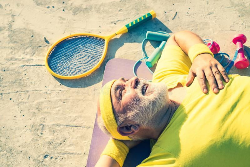 Energetic for elderly sportsmen. Happy active old man holding exercise mat. Grandfather sportsman. Fit senior man royalty free stock images