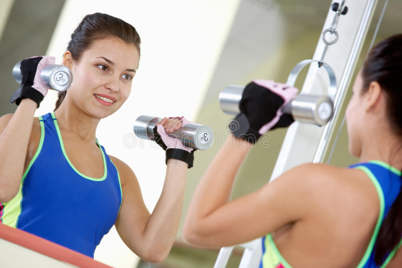 Download Energetic exercise stock photo. Image of dumbbells, brunette - 16933946