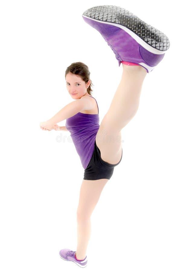 Energetic girl doing kick royalty free stock photography