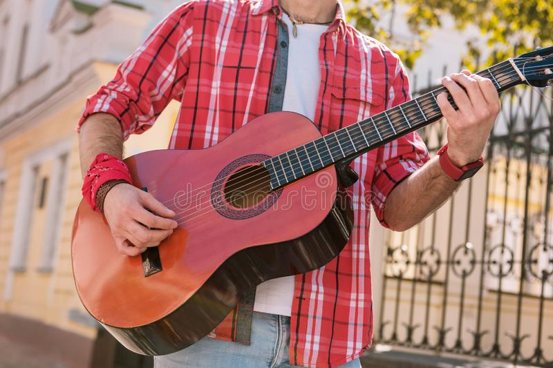 Energetic street musician granting song on street stock photos